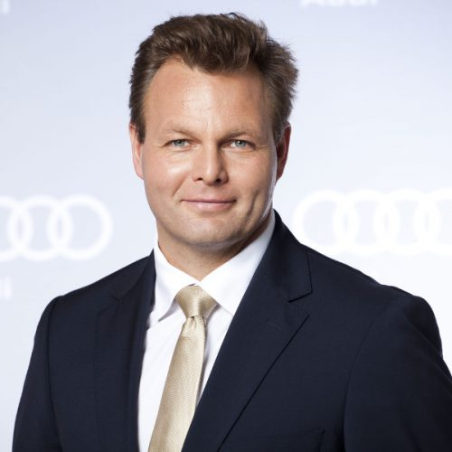 "Ulrich Schwarze </br><img src=""https://cmcx.com/wp-content/uploads/2018/01/Audi-Logo.png"" style=""max-width:140px;width:140px;height:auto;margin-top:12px;"">"